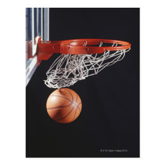 Basketball in hoop, close-up postcard