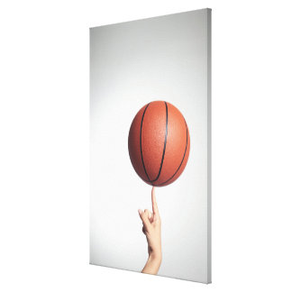 Basketball on index finger,hands close-up gallery wrap canvas