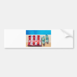 Bathing slippers and bath towel at swimming pool bumper sticker