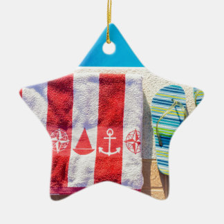 Bathing slippers and bath towel at swimming pool ceramic star ornament