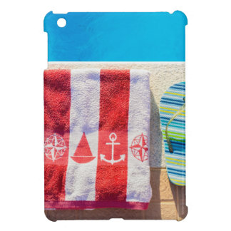 Bathing slippers and bath towel at swimming pool cover for the iPad mini