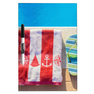 Bathing slippers and bath towel at swimming pool dry erase board