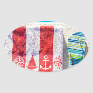 Bathing slippers and bath towel at swimming pool oval sticker