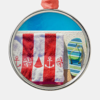 Bathing slippers and bath towel at swimming pool Silver-Colored round ornament