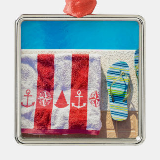 Bathing slippers and bath towel at swimming pool Silver-Colored square ornament