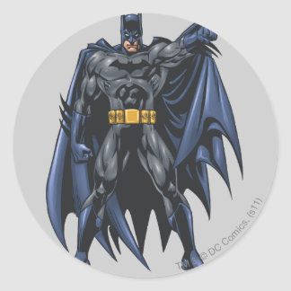 Batman holds up cape classic round sticker
