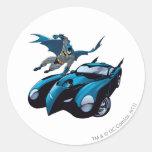Batman swings over round stickers