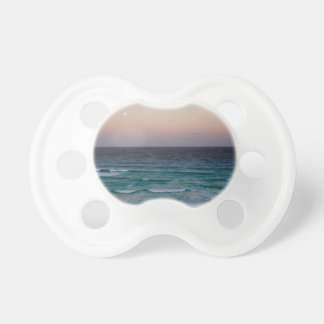 Beach and sky at sunset time pacifier