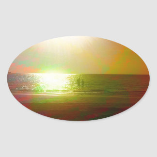 Beach and sunlight in color oval sticker