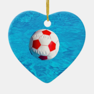 Beach ball floating  in blue swimming pool ceramic heart ornament