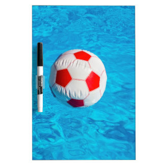 Beach ball floating  in blue swimming pool Dry-Erase whiteboards