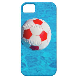 Beach ball floating  in blue swimming pool iPhone 5 cases