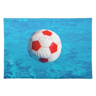 Beach ball floating  in blue swimming pool placemat