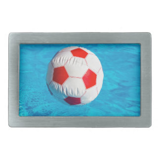 Beach ball floating  in blue swimming pool rectangular belt buckles