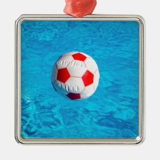 Beach ball floating  in blue swimming pool Silver-Colored square ornament