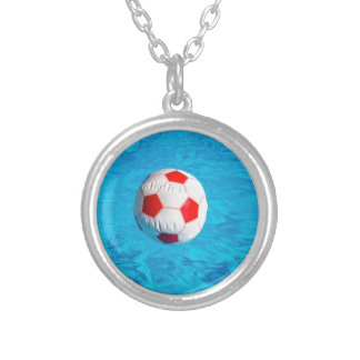 Beach ball floating  in blue swimming pool silver plated necklace