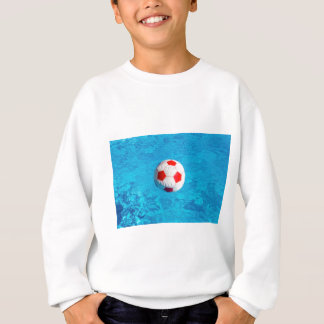 Beach ball floating  in blue swimming pool sweatshirt