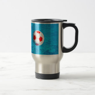 Beach ball floating  in blue swimming pool travel mug