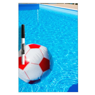 Beach ball floating on water in swimming pool dry erase whiteboards