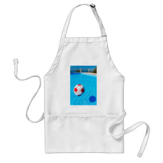 Beach ball floating on water in swimming pool standard apron