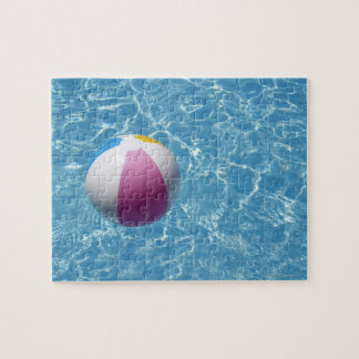 Beach ball in swimming pool jigsaw puzzle