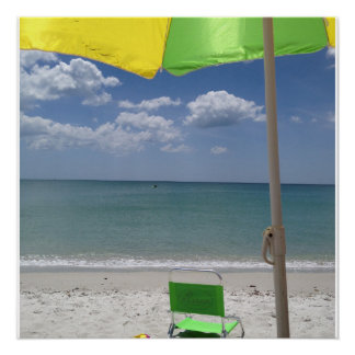 Beach chair and umbrella on the beach poster