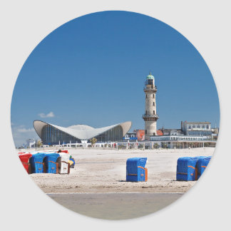Beach chairs and lighthouse in Warnemuende Classic Round Sticker