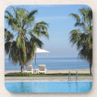 Beach Chairs and Umbrella, Palms, Ocean, Pool Coaster