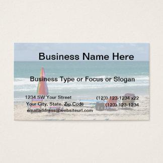 beach chairs surfboards umbrellas sand ocean business card