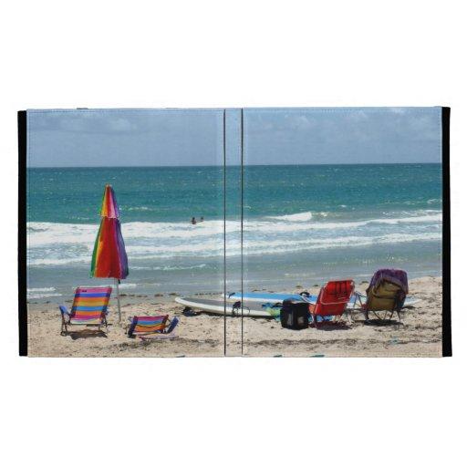 beach chairs surfboards umbrellas sand ocean iPad folio cover