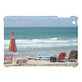 beach chairs surfboards umbrellas sand ocean cover for the iPad mini