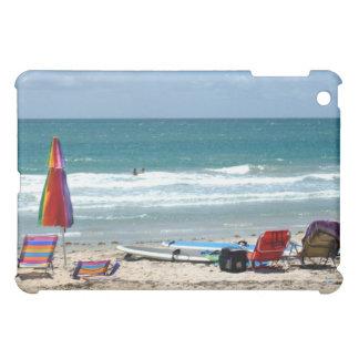 beach chairs surfboards umbrellas sand ocean sm iPad mini cover