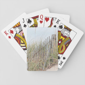 Beach fence in the sand dune playing cards