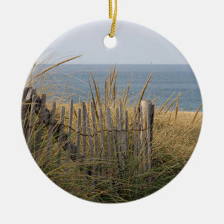 Beach fence in the sand dune round ceramic ornament