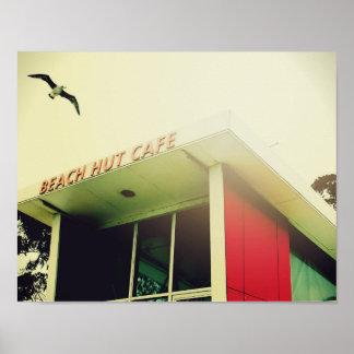 Beach poster with bird beach hut cafe