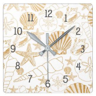 Beach themed decor, gold white sea shells square wall clock