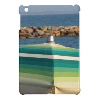 Beach umbrella on sea background iPad mini cases