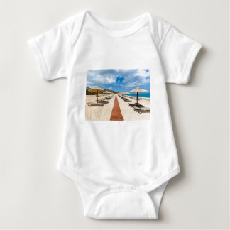 Beach umbrellas and loungers at greek sea baby bodysuit