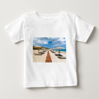 Beach umbrellas and loungers at greek sea baby T-Shirt