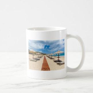 Beach umbrellas and loungers at greek sea coffee mug