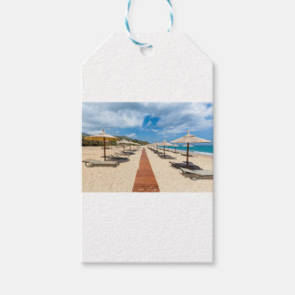Beach umbrellas and loungers at greek sea gift tags
