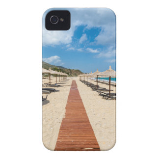 Beach umbrellas and loungers at greek sea iPhone 4 cases