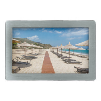 Beach umbrellas and loungers at greek sea rectangular belt buckles