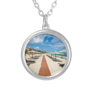 Beach umbrellas and loungers at greek sea silver plated necklace