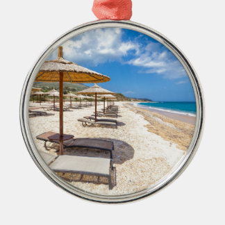 Beach umbrellas in rows on sandy beach with sea Silver-Colored round ornament