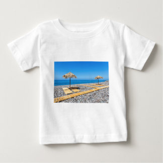 Beach umbrellas with path and stones at coast baby T-Shirt