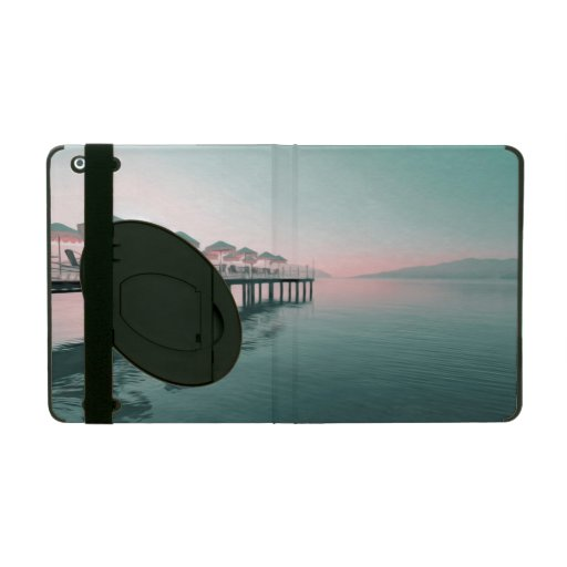 Beach with pier and umbrellas iPad covers