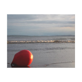 Beach With Waves Washing And Red Buoy Canvas Print