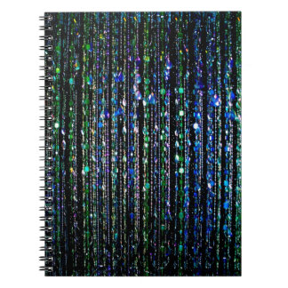 Beads, blue and green notebooks