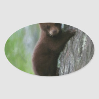 Bear cub in Tree. Oval Sticker
